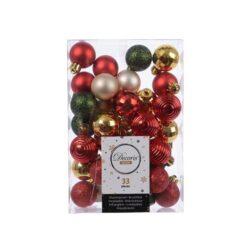 små julekugler og plastikstjerner i  rød grøn guld og perlemor sortiment til juletræ og juledekorationer