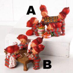 julefigur med fire babynisser som bager og pynter honninghjerter til jul