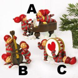 julefigur cirka 6 centimeter høj med babynisse spiller julemusik på kontrabas