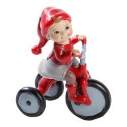 nissefigur apoteker nissen peder på trehjulet cykel