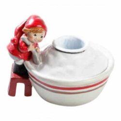 Pixie Figur Kerzenhalter mit Apotheken Pixie Anna auf Hocker von großen Schüssel Reisbrei
