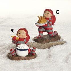 babynisse står med gåsesteg til juleaften på et fad